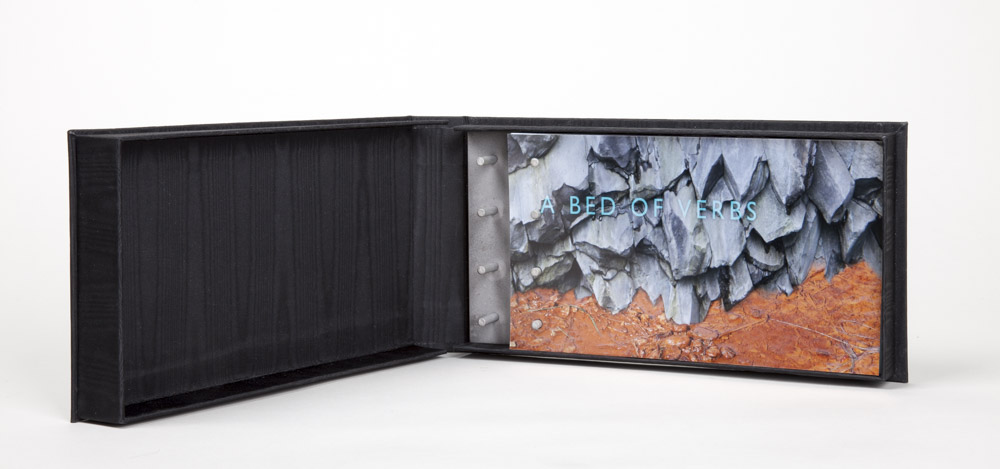 A Bed of verbs - 2014; edition of 4.Artist Book with clamshell box and bedsprings:  Digital prints on Moab Entrada 190 rag paper & metal coated papers.9.75 x 5.25 x 1 inches (closed box)Artists: Brooke Holve & Elizabeth Sher.