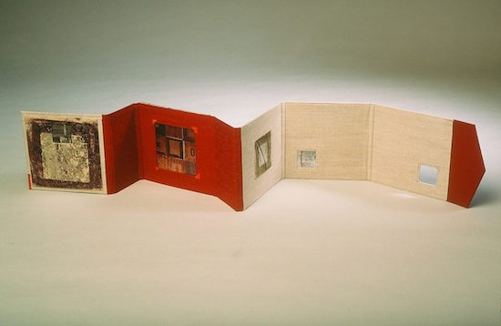 s & s of a package  - 1999.Accordion Fold Book: book board &cloth, found objects, acrylic transfer.32 x 5.5 inches