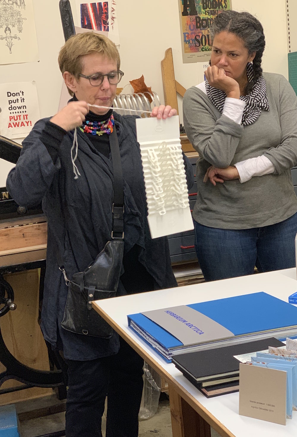 Helga Palina Bryjolfsdottir (Iceland) showing her artist book with Tiana Krahn looking on
