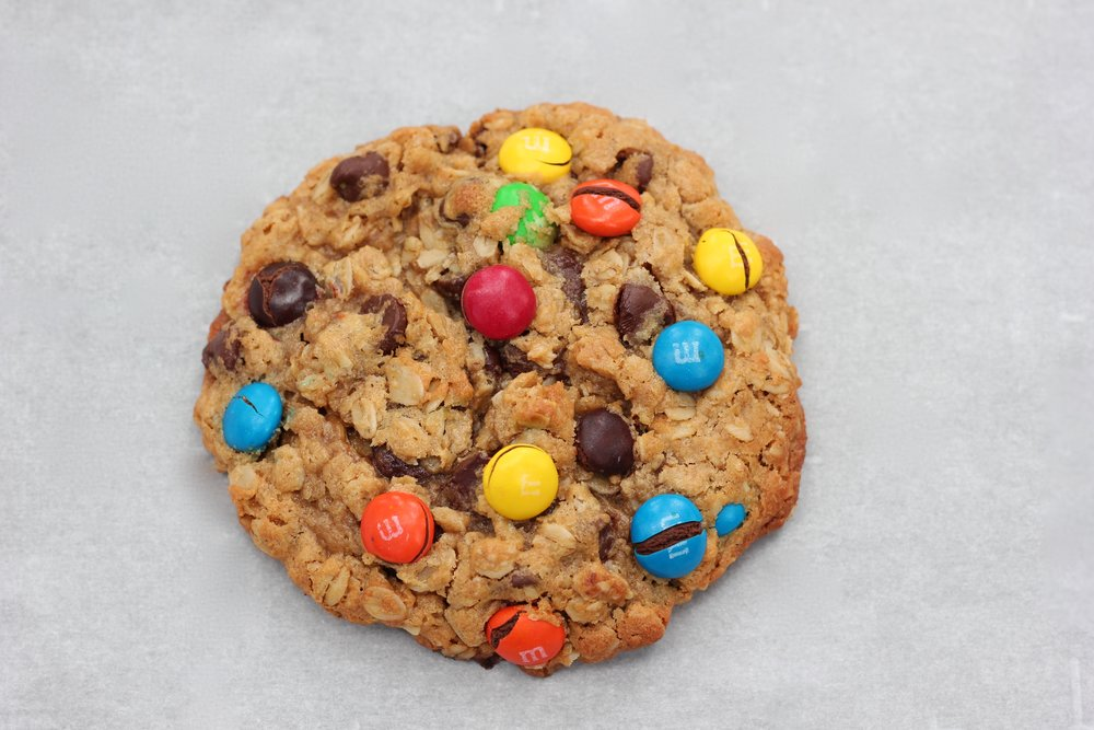 Monster Cookie - Warning: Not for the faint of heart. These are not just cookies, this incredible peanut butter cookie is loaded with M&Ms, chocolate chips, and savory oats that just may leave you dumbfounded that monsters can actually taste good!