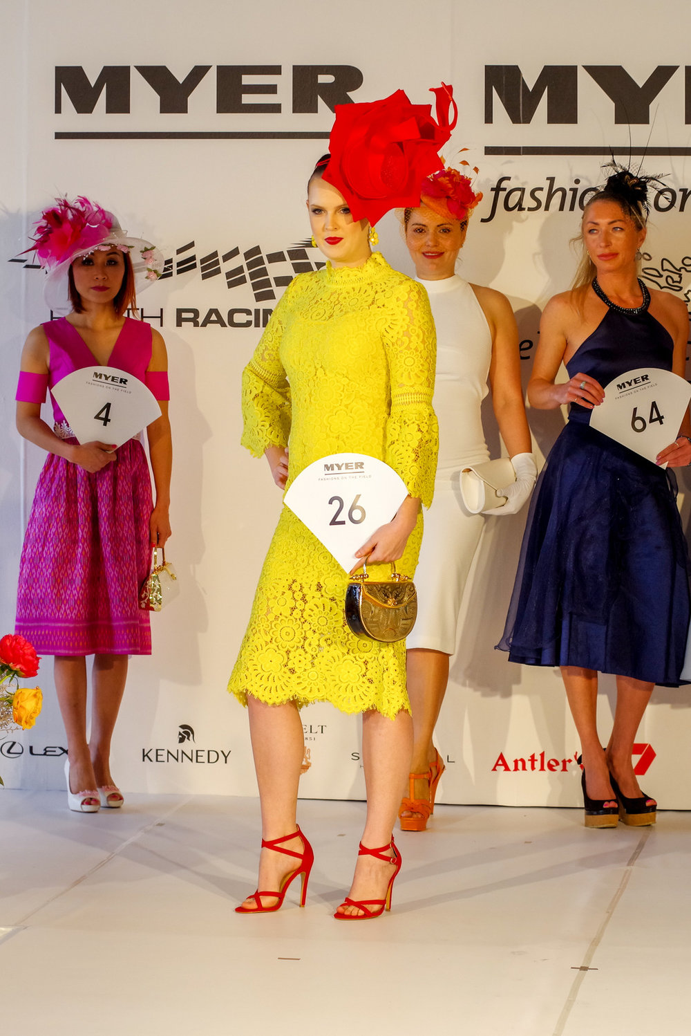Luka Hasset wowed in Best Dressed Accessories bright yellow midi dress complimented with red shoes and millinery.