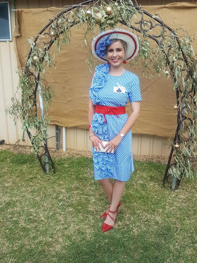 Shanny Hopkins in our blue gingham ruffle dress and red reel him in belt - won best dressed lady and best dressed couple xoxo well done beautiful