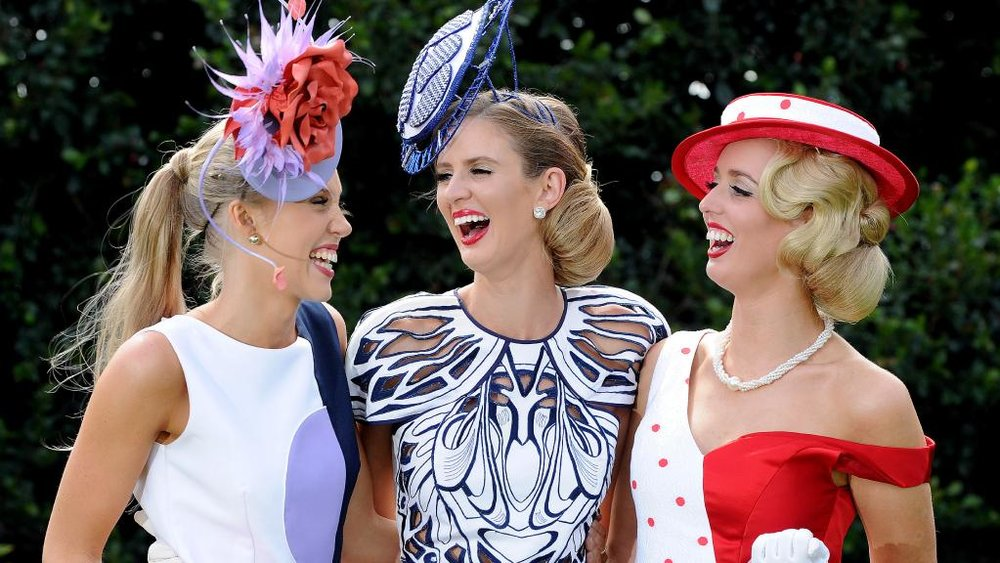 Adelaide Cup Fashions on the Field winner Courtney Moore, middle, celebrates with fellow Victorian