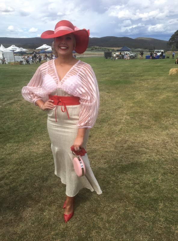 Shan Wilson in our Red Reel Him in belt, red half palms and round bag