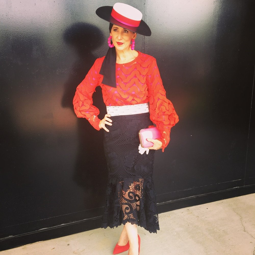 How clever is Sally stacking lace textures with pops of red and pink on a black base