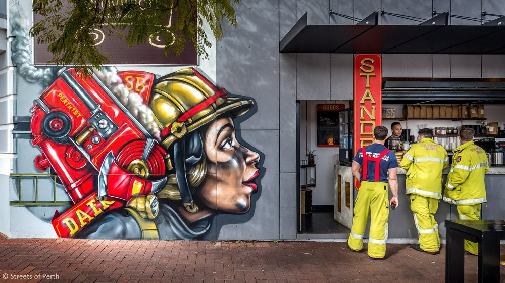 STAND BY - LOCATED IN INNER CITY SUBURB MOUNT LAWLEY. A HOLE IN THE WALL COFFEE SHOP OWNED AND OPERATED BY LOCAL FIRE FIGHTERS. HENCE THE THEMED CUSTOM DESIGN HAND PAINTED LOGOS AND AEROSOL MURAL.