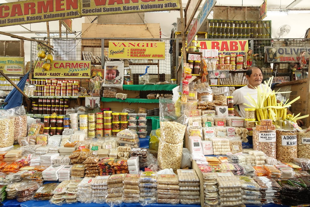 TINDAHAN - Market fulkl of kasoy (cashews) peanuts and suman (sticky rice) in one of my favorite cities, Antipolo Rizal.