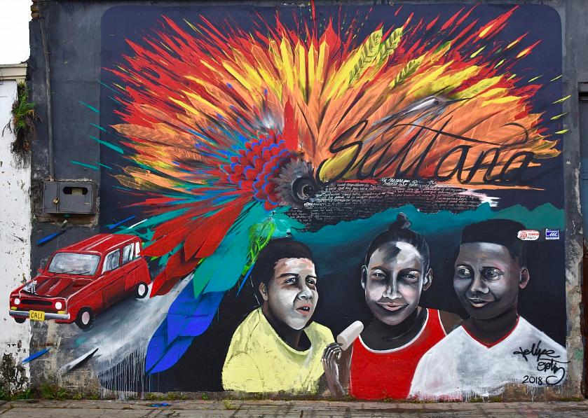 """""""Los Niños Son el Futuro del Barrio"""" Felipe Ortiz, 2018.  18ft x 25ft mural in El Piloto, Cali, Colombia. Vinyl paint and spray paint."""