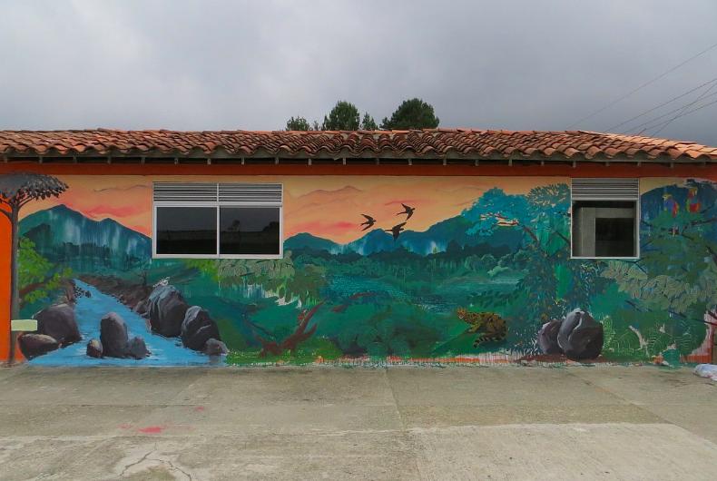 Santa Elena Hermosa, Cuídala. Felipe Ortiz, 2016.  (School in Piedra Gorda village, Santa Elena, Colombia) 10' x 42' Acrylic vinyl on wall.