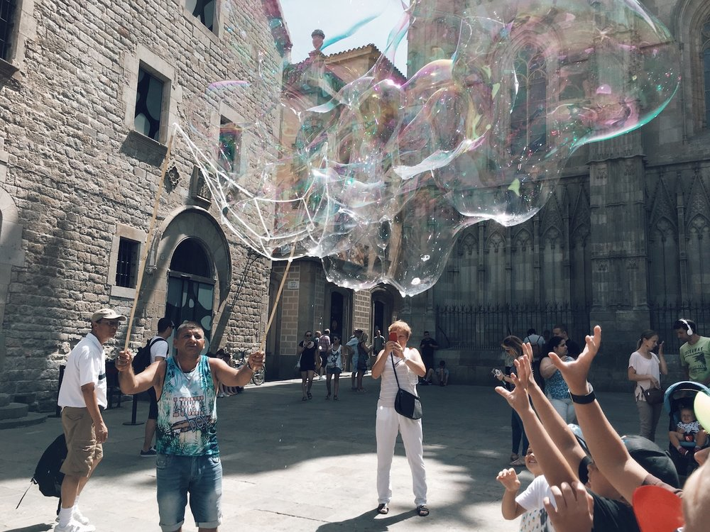 Street Bubble Performer in front of Barcelona Cathedral