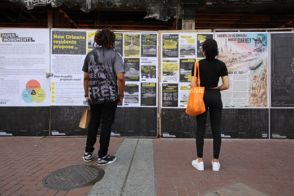 Passers-by read Public Proposal panels at the Canal Street site.