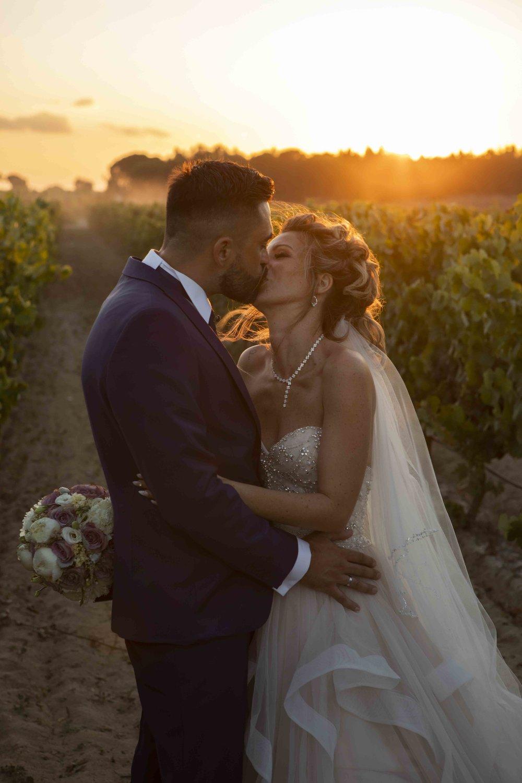 sunset kiss wedding