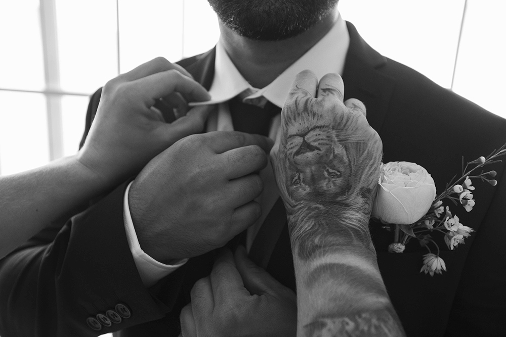 hands and tie groom