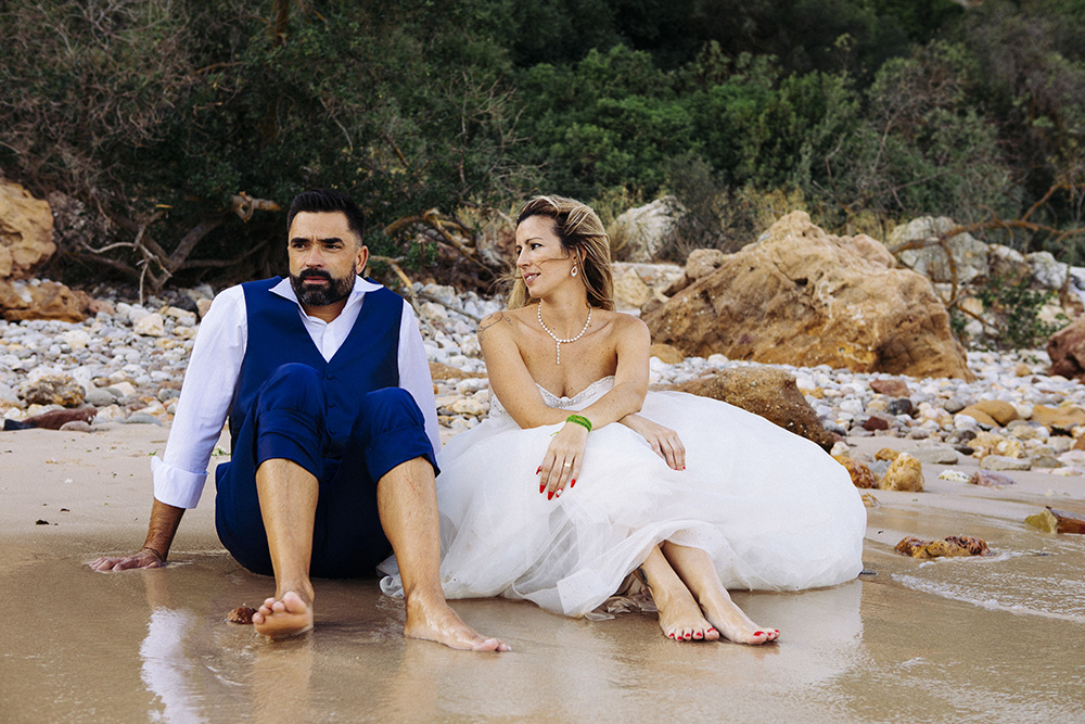 groom and bride in the sand