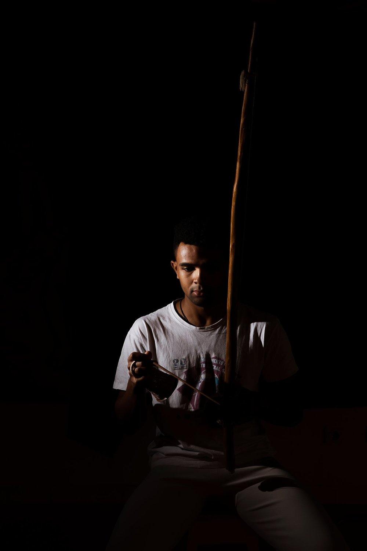 Capoeirista Play Berimbau