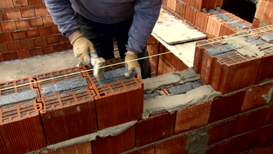 351550084-brick-building-construction-worker-sardinia-building-constructing.jpg