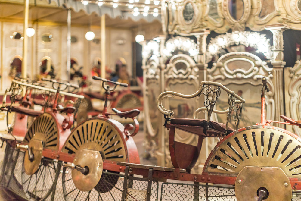 """Our guide explained that there were many who could not afford the powered carousels and this was an alternative. The explanatory notes in the program add that in the early days of pedal power there were more bicycles in the fairgrounds than on the streets and people wanted to """"have a go on one."""""""