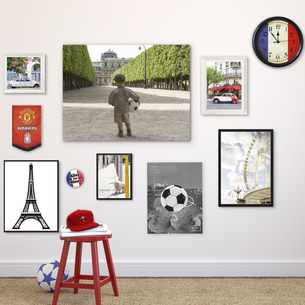 An example of a gallery wall in a young boy's bedroom. This one is easy to add to as he collects new interests and items.