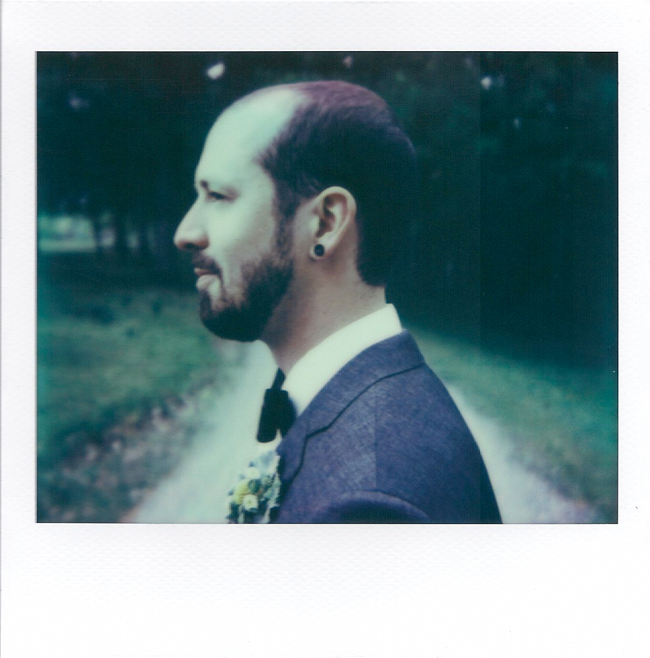 Polaroid portrait of groom at Oak Hill