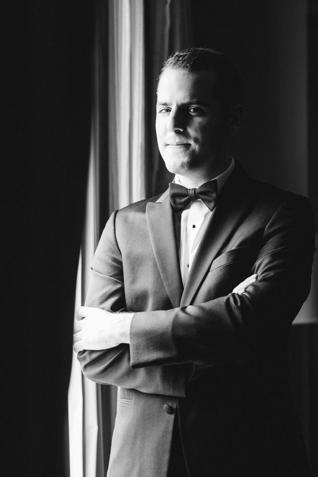 groom portrait, window light, hotel room