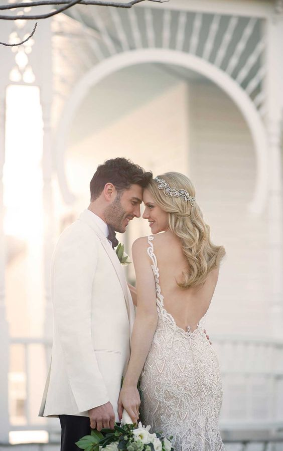 LOW BACK WEDDING DRESSES - For the ultimate in both glamour and drama, backless wedding dresses can be the ideal choice for anyone - from the laidback to the sophisticated bride.