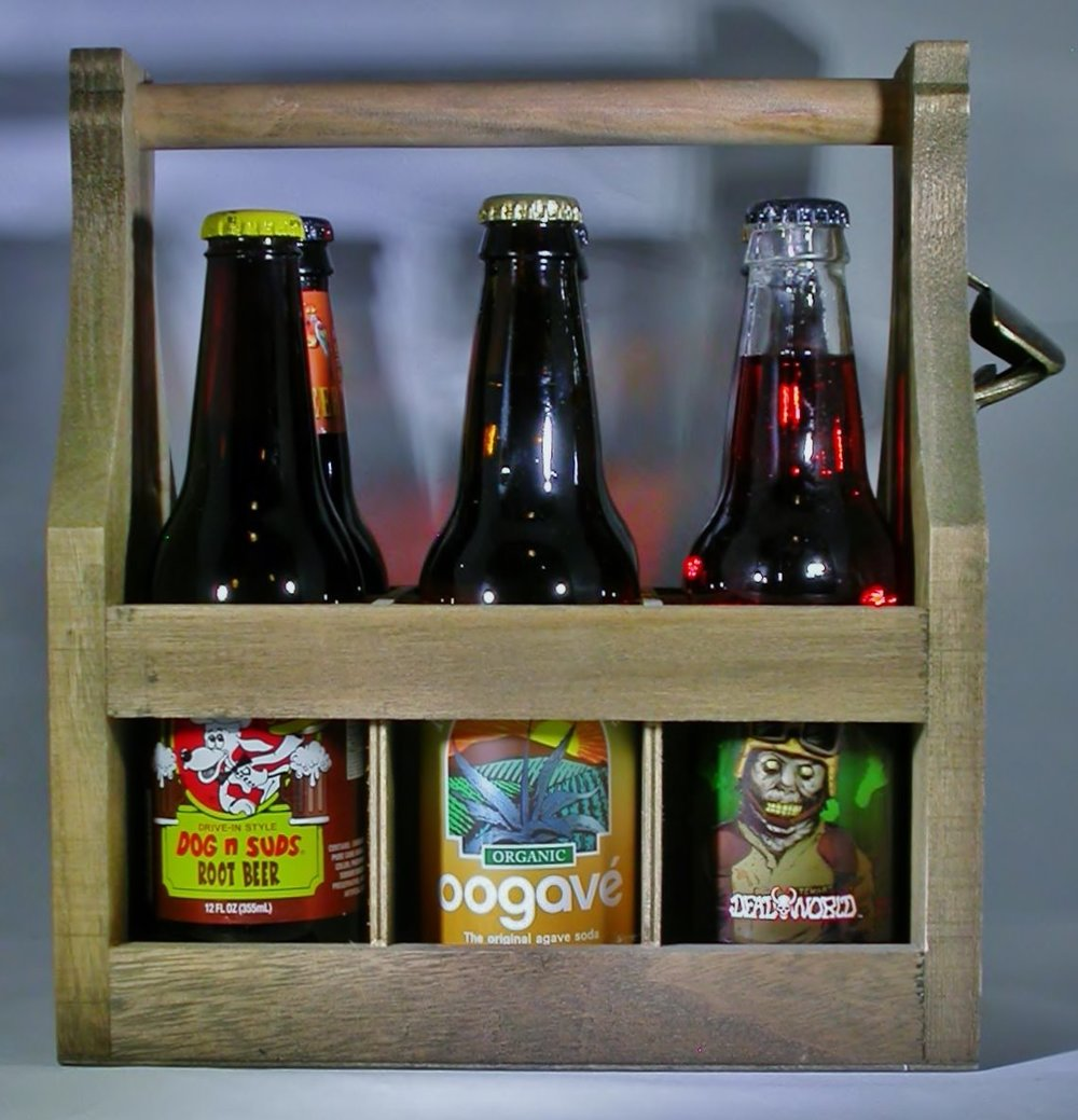 Based on popular demand, we are now offering our wooden six pack beverage holder with your choice of hand-crafted soft drinks as a holiday gift pack. Supplies are limited to come early to one of our upcoming events!