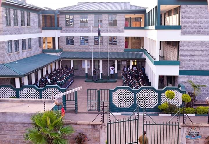 school with students in courtyard.png