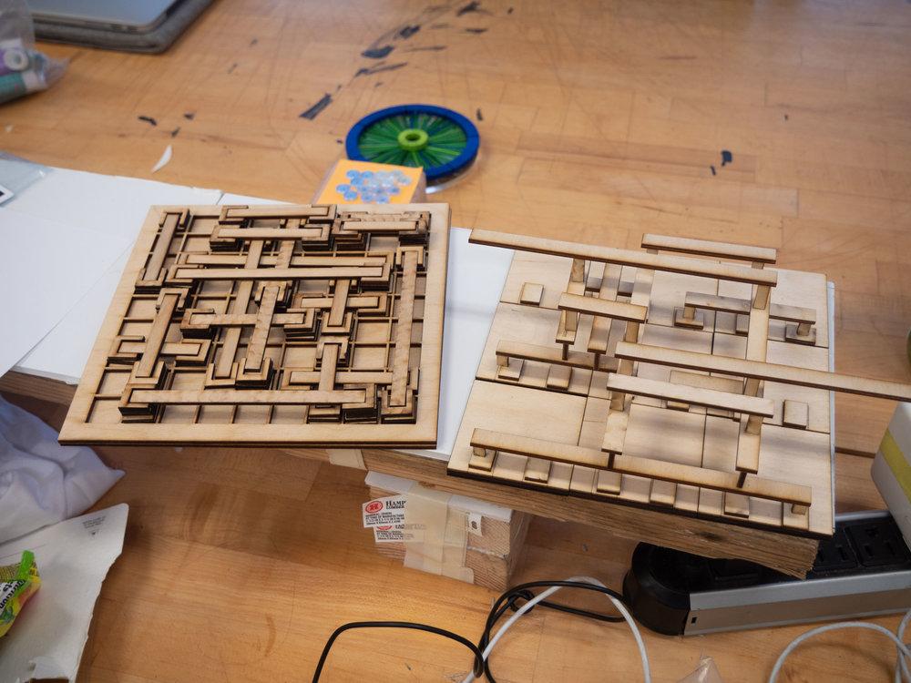 Early laser-cut wood models.