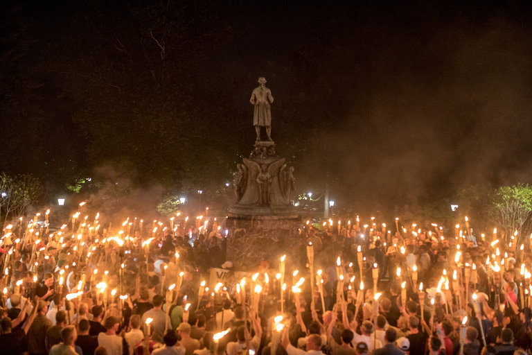 """Photo:Edu Bayer for The New York Times   The photo above shows about 150 white supremacists converging on a small group of about 20 students who linked arms around the statue. The students were there to protest against racist and anti-Semitic actions taken by the white supremacists. The Tiki-bearing neo-Nazis, KKK, alt-right, and white supremacists (really- all are sort of merged together into one hate-filled group) were there to protest the renaming of the Lee Park to Emancipation Park as well as the plan to take down the Robert E. Lee statue. This is Friday night. Saturday erupted and culminated with a neo-Nazi driving into a crowd of people who gathered for inclusion. One dead and more than thirty injured were the results of that act of domestic terrorism. Trump first blamed """"both sides"""" as if they are somehow equally to blame and after two days of intense blow back from even his own party, he managed to read from a tele-promoter words that condemned the white supremacists. He had all the enthusiasm of a prisoner forced to read a letter by captors. When the Merck CEO stepped down from Trump's business council, it took less than an hour for Trump to ridicule him. It took two days and strong pressure to get a sullen president to say the words.    Really- what will it take? When will Chuck Fleischmann, John Ragan, Terry Frank, and all the other Anderson County Republicans actually stop enabling this madness and begin calling it for what it is? A recent Qualrics poll (June 2017) shows 52% Republicans would support putting off the 2020 presidential election due to """"voter fraud"""". Despite the Constitution saying otherwise. What will it take? Trump to declare himself """"President-for-life"""" with an adoring Pence gazing in admiration at him? Trump to fire anyone investigating his presidential plundering and collusion with Putin? Trump to close down the free press as """"enemies of the state""""? Or maybe this will do it. Trump showing his willingness to support white supremacists """