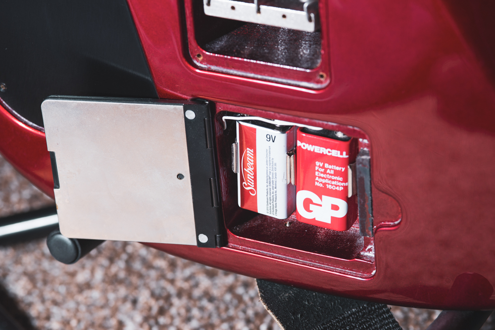 The battery cavity has a magnetic, shielded door helping to make battery changes quick and easy. So far the sustain pickup has not drained the batteries too quickly, and only operates if the guitar is plugged in.