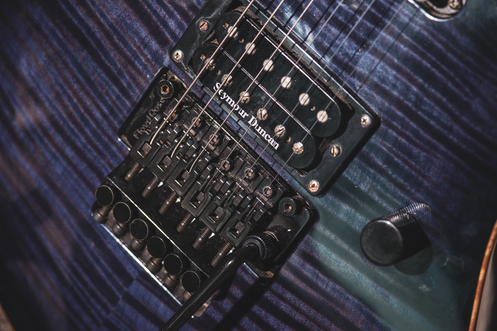 Figured maple top, german Floyd Rose, and the volume knob is a push/pull coil splitter for both pickups.