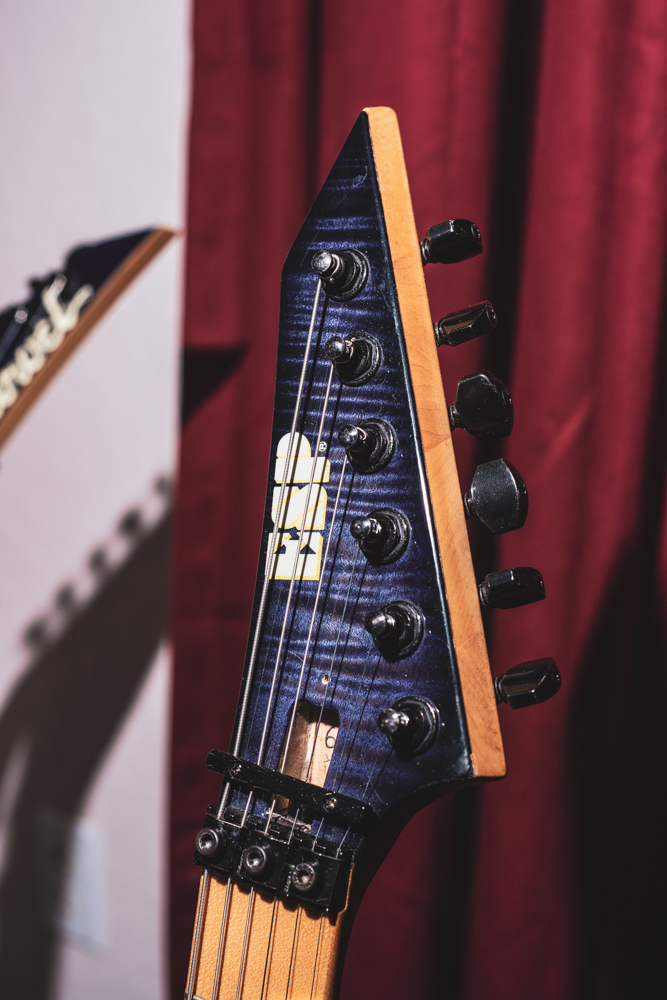 The headstock is a reverse ESP pointy which matches the body's flamed maple finish.