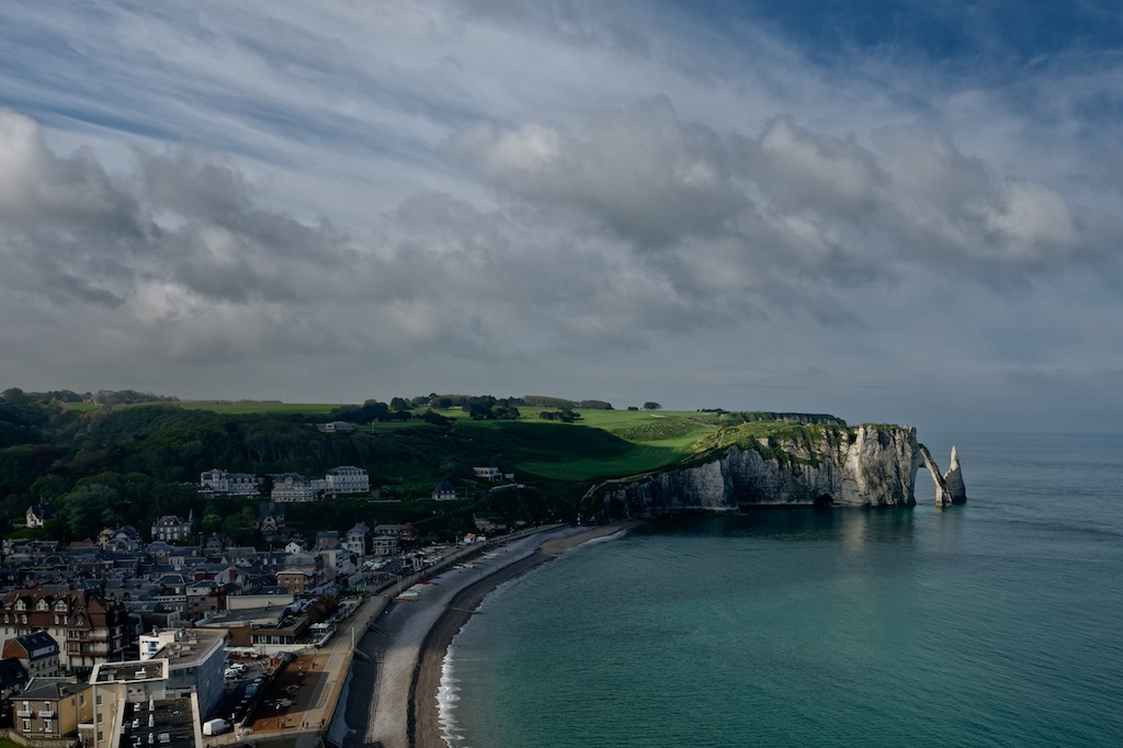 The white Etretat cliffs with his arch and the small town