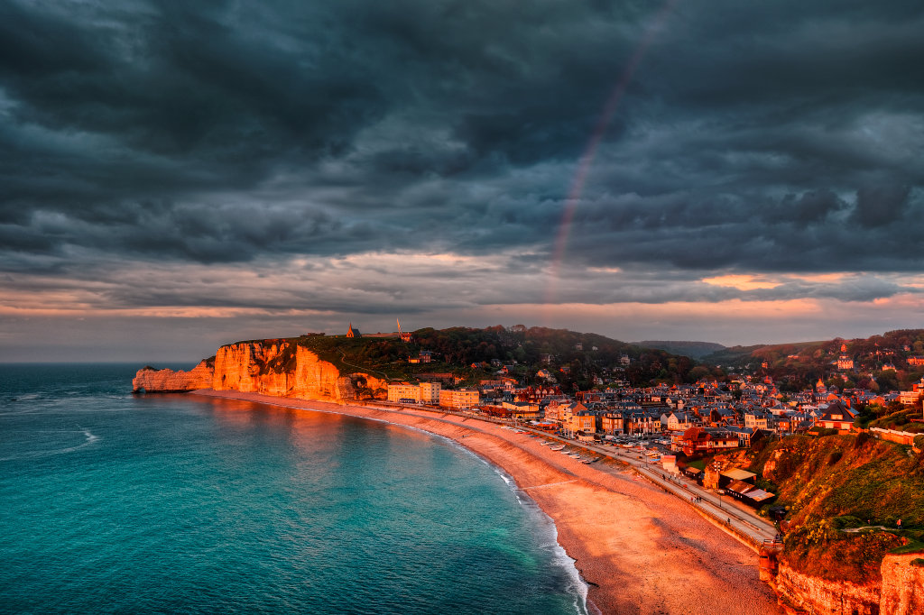 A wonderful rainbow over the Etretat cliffs during the golden hour