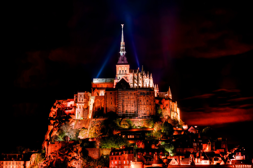 A night view of Mont Saint Michel with lights and clouds