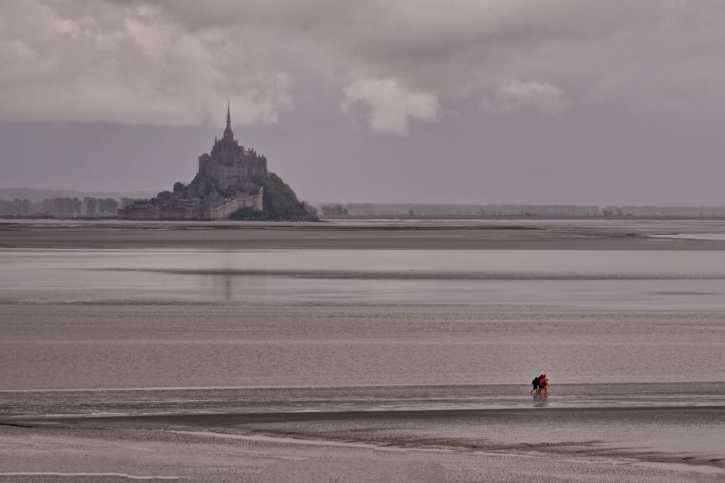 People walk in the Mont Saint Michel Laguna