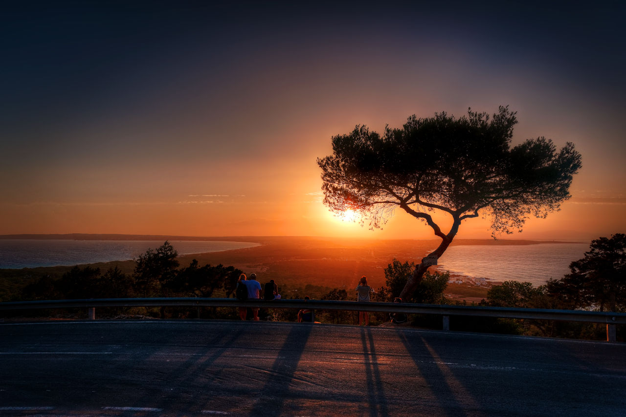 Some people are photographing the sunset in Formentera
