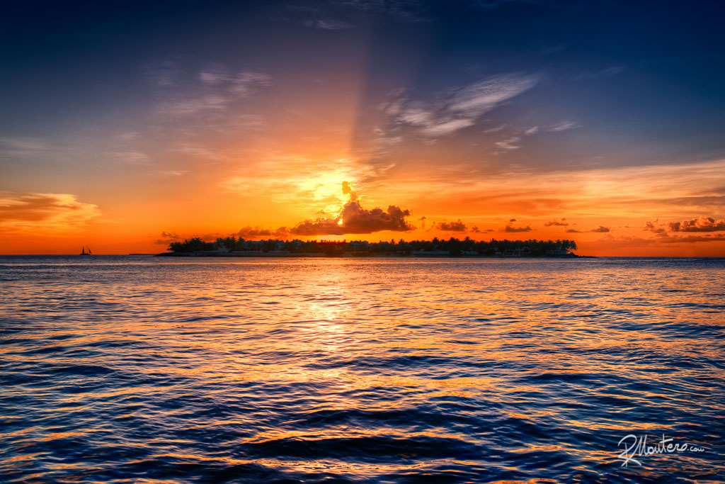 The Sun sets behind Sunset Key in the Florida Keys