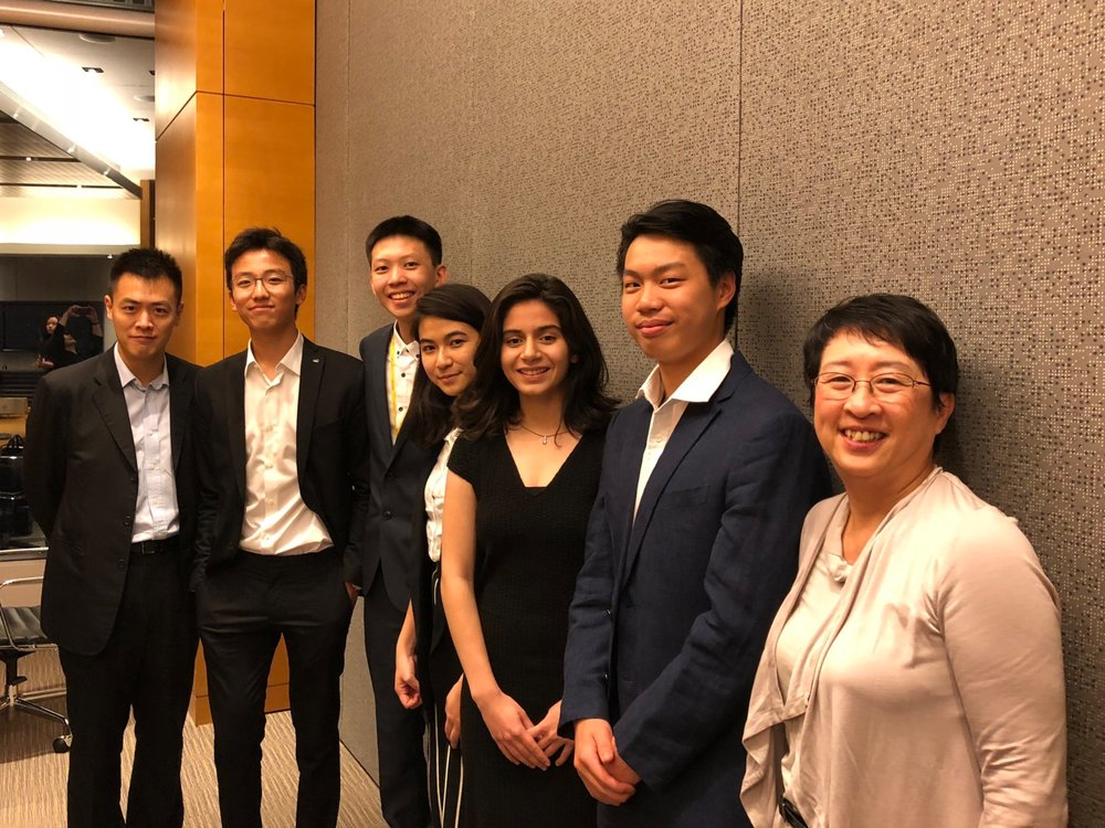 Mr. Ming Wai Lau, GBS, JP, Chairman (1st Left), Mr. Dickson Yau, Vice President Administration (2nd Left), Mr. Alex Yu, President (Designate) (3rd Left), Ms. Francisca Lam, Co-Vice President, Operations (4th Right), Ms. Sana Khullar, Co-Vice President, Operations (3rd Right), Mr. Chad Ho, Youth Director, Board and President's Office (2nd Right), Mrs. Peonie Wong, Executive Director (1st Right)