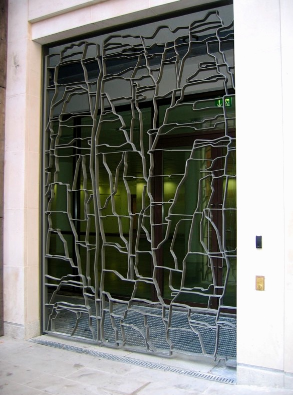 4-6 Savile Road, London W1 - Wrought iron gate2006240 x 344 cm-Gate located on Heddon Street, off Regent's StreetBuilding architects: Squire & PartnersFabrication: STG MetalDesign references the subtle striations in the portland stone that clads the building