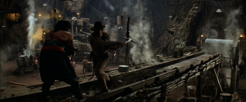 Indiana Jones Temple of Doom conveyor belt Harrison Ford material handling automation