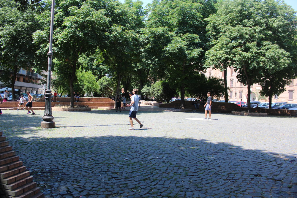 Local kids playing a game of pick-up football.