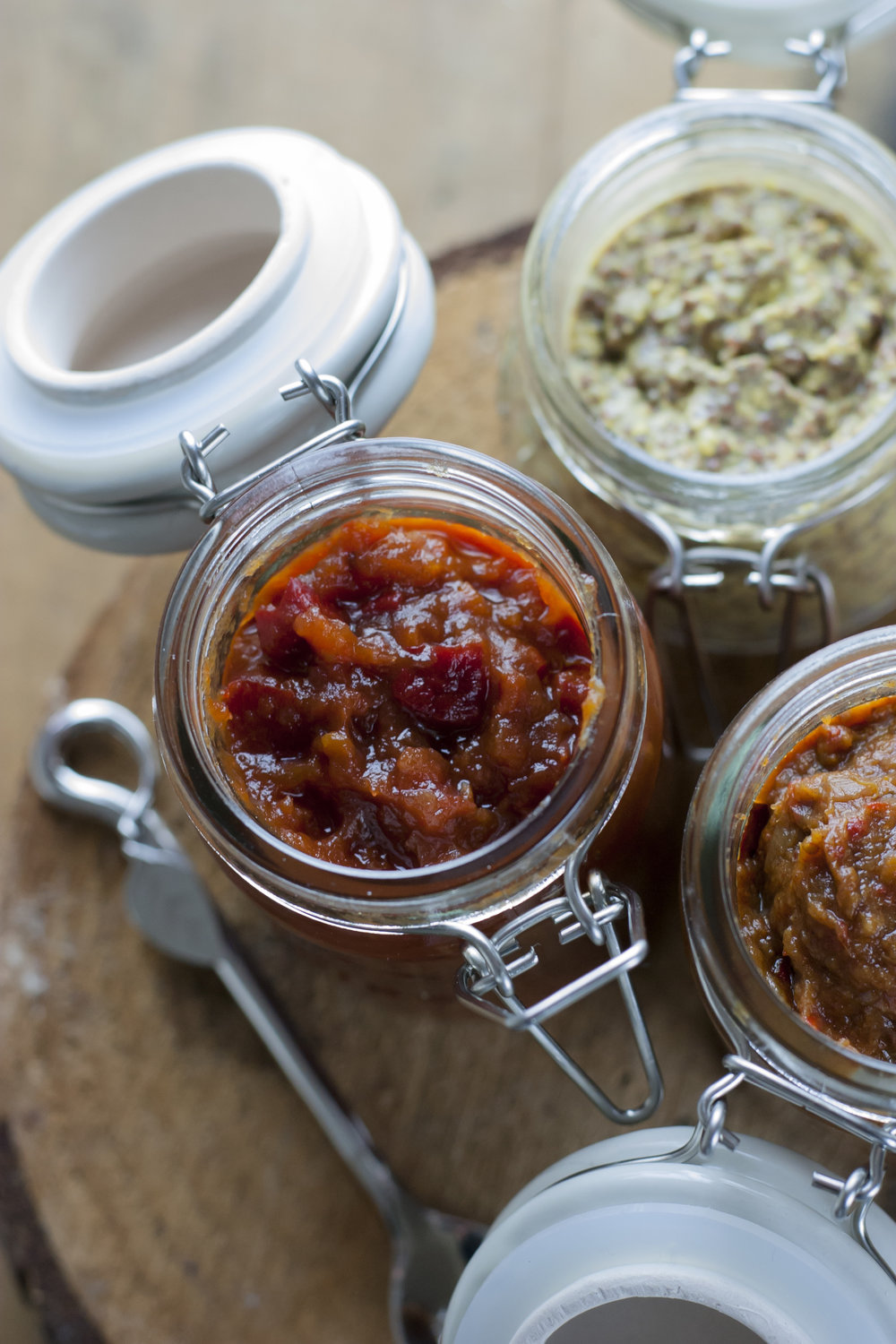 Three jars of chutneys viewed from above