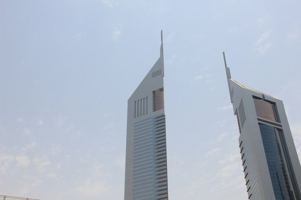 The Emirates Towers are like two giant soldiers guarding the desert city.
