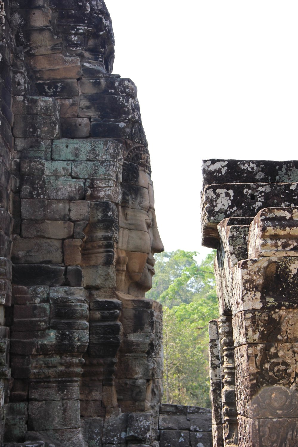 "Giant, mysterious faces are carved into the Bayon Temple at Angkor Thom. They have been called many names over the years but our favourite is the ""Mona Lisa of Asia"", they just have that mysterious smile on their face that makes you wonder if they are alive."