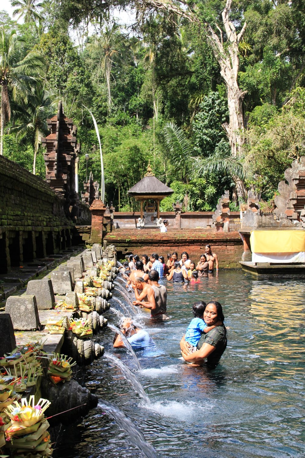 There are many temples to visit in Bali, but Tirta Empul should definitely be in your priority list. It is located in the middle of the jungle and it is said to have purifying waters.