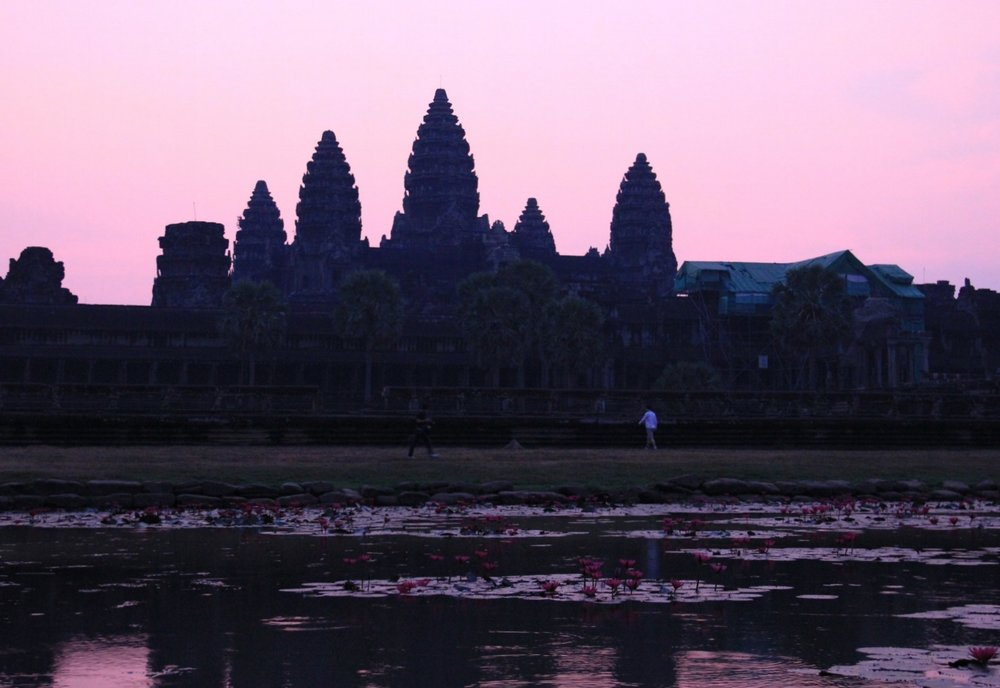 Angkor's vast complex of intricate stone buildings includes preserved Angkor Wat, the main temple, which is pictured on Cambodia's flag.