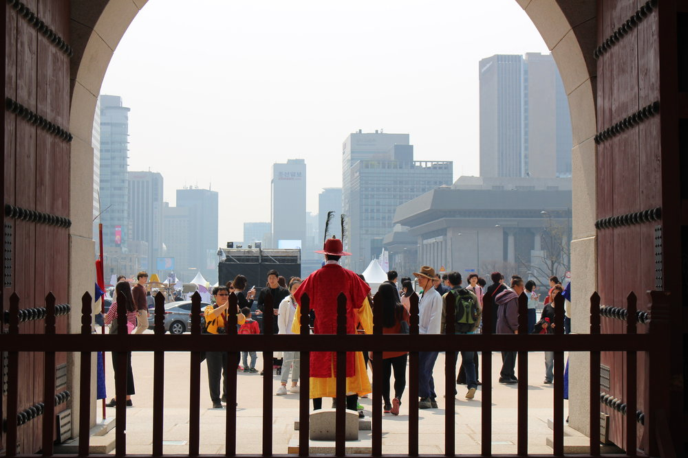 From inside the palace grounds, you look outward to one of the most modern cities in the world, Seoul.
