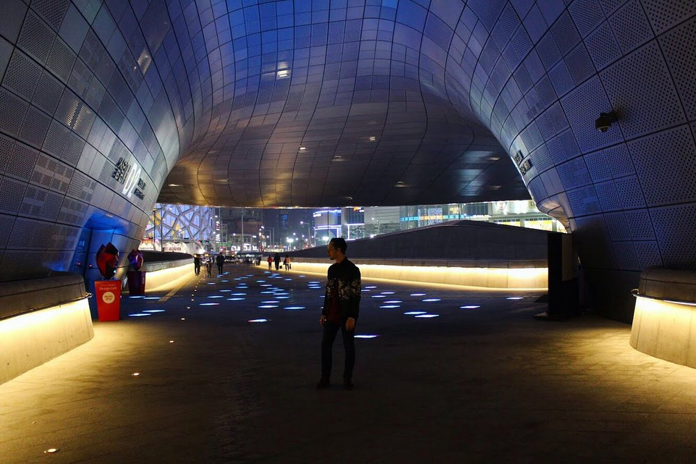The Dongdaemun Design Plaza is designed by Zaha Hadid. It is absolutely one of the coolest structures you'll ever see. This here is also one of Seoul's main shopping districts. Food stalls are opened into the late hours and some of the shops are almost opened until sunrise.