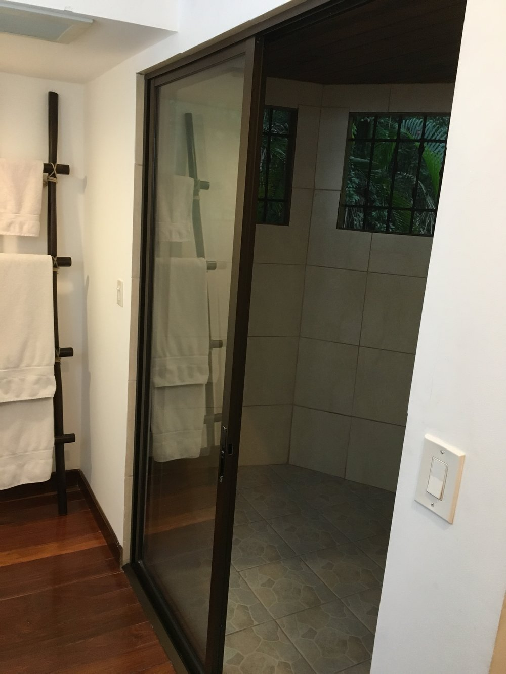 Indoor/outdoor shower in master bedroom